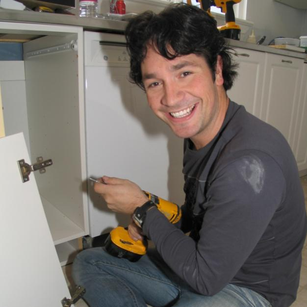 Tyler working on the kitchen cabinets